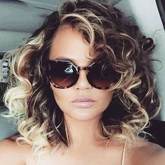Retro Curls - While embracing her natural length sans extensions, Chrissy wore curls to give off a full-on '80s vibe. Golden tones added depth to her spirals, resulting in an even more bountiful head of hair.