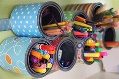 Organizing art supplies with tin cans and a magnet strip
