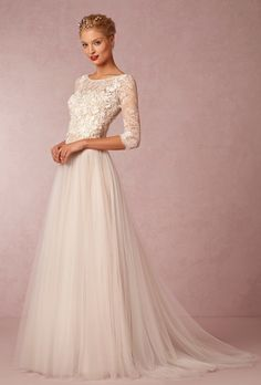Brides: BHLDN. Romantic ivory gown features top-applied flowers on illusion tulle, sheer three-quarter sleeves and a full layered skirt.