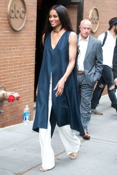 Who: Ciara What: A Voluminous Tunic Why: The statuesque singer looked ultra elegant in a open navy tunic worn over wide-leg cream trousers. Get the look now: The Row tunic, $3,690, net-a-porter.com.   - HarpersBAZAAR.com