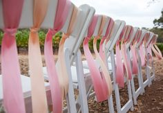 bright ribbons on Ceremony Chairs // photo: Christine Chang Photography // Feature: TheKnot.com