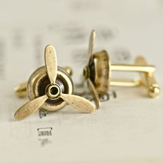 Little Propellers Cuff Links~~These would be great for my friend who loves to fly!!
