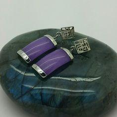 Purple Jade Sterling Silver Dangle Drop Earrings Pretty simple purple jade encased in sterling silver, dangling from a detailed symbol post.  Perfect condition. Jewelry Earrings