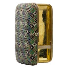 OVCHINNIKOFF Original Enamel Silver Gold-Plated Cigarette Case.  This original antique cigarette case was made by the famous Russian silversmith Pavel Ovchinnikoff. The exterior of this silver case features a striking multi-colored hand-made enamel basket design.  The interior is plated in yellow gold.
