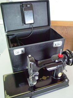 Singer Featherweight! This is my dream machine so if anyone really wants to bless me ....hint hint....lol.