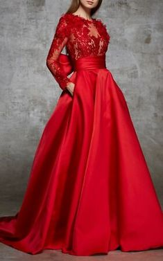 Shop Lace And Satin Gown With Back Bow. This **Marchesa** gown features a high rounded neckline, semi sheer bodice with organza and lace petals, and long lace sleeves. Satin Gown, Satin Dresses, Red Lace Gown, Marchesa Gowns, Evening Dresses, Prom Dresses, Bridal Fabric, Lela Rose, Bustier Top