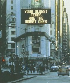 """commovente:  Jenny Holzer, Times Square Sign, 1982 The language of Truisms, obdurate and internally consistent, heralded a voice that is striking not least for its paradoxical anonymity. Truisms pull no punches and as the title suggests, seem to reflect wisdom long since received. Hal Foster, writing in 1982, called Trusims """"verbal anarchy in the streets."""""""