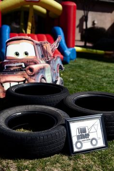 Cardboard cars obstacle course, run through tires, complete a pit stop (change a tire?), refuel (drink a glass of water), do a lap backwards as mater, etc.