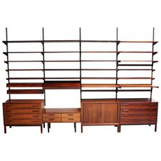 Extraordinary Nine-Bay Rosewood Wall Unit by Kai Kristiansen | From a unique collection of antique and modern shelves at https://www.1stdibs.com/furniture/storage-case-pieces/shelves/