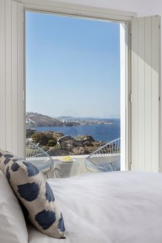 The suites artfully combine traditional Mykonos style (whitewashed walls, chunky stone floors, wooden shutters) and a bohemian aesthetic (bright Acapulco chairs, rustic light fixtures, bold graphic print fabrics). Boheme Mykonos (Mykonos, Greece) - Jetsetter