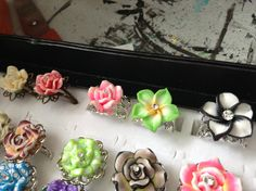 Bronze and silver filigree rings with polymer flowers and centered with clear gems