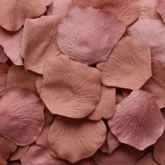 """Loose silk rose petals in a romantic vintage antique pink. 100 petals per bag measure 1.75-2.25"""" in diameter each. Perfect for scattering on table tops or to be used for flower girl baskets. Petal Dec"""