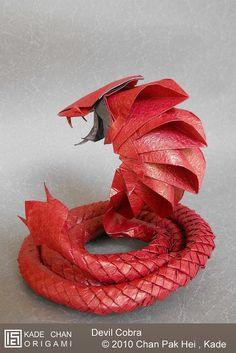 Devil Cobra 魔鬼眼鏡蛇 by kade chan, via Flickr Designed and Folded by : Kade Chan 2010 Uncut 10x360 (1:36) single piece of tissues-foil paper, Completed model : 25cm, Time spent : 15 hours, Wet folding