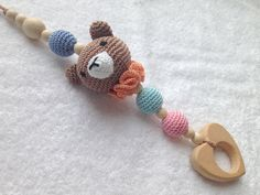 Bear hanging toy, play gym toy, wooden teething toy, Car seat toy, Stroller Toy, Shower, New Born Baby Gift, Baby Rattle, crochet. This hanging toy features a crochet bear with wooden beads and wooden teething heart. A carefree bear will add happiness and fun to your baby's plays. Suitable for babies to hold in their small hands. There are small bells inside the bear so it makes pleasant sounds when a baby plays with it. Soft crochet animal is handcrafted with a heart shaped teething toy...