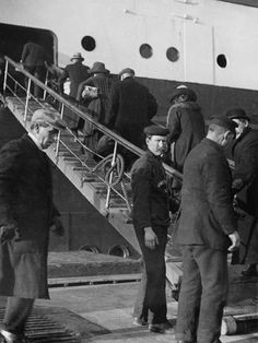 Second Class Passengers. Second Class Passengers boarding RMS Titanic from the tender 'Ireland' , April 10th 1912. The crew are wearing White Star jumpers.