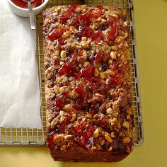 For anyone who's ever tried a peanut butter-banana sandwich, this one's for you! Banana bread is baked with peanut butter right in the batter, then drizzled with strawberry jam and topped with peanuts. Try it once and you'll be hooked!/