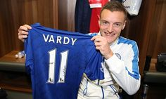 Jamie Vardy shows off his signed shirt from the game against Manchester United