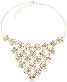 This Wurl necklace boasts a 3.5 in. bib silhouette with flower accents and clear stone embellishment, gold tone chain and lobster claw closure. Necklace measures 17.5 in. with a 3 in. extender.