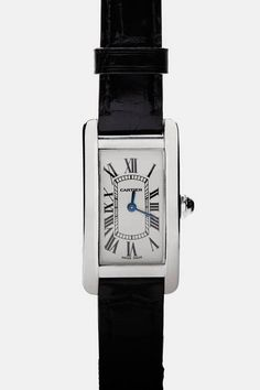 From the vintage trove of Camilla Dietz Bergeron comes this Cartier Tank Américaine (small model). The powerful yet elegant timepiece has an elongated case with a more pronounced curve than the original Tank created in 1917 by Louis Cartier. It playfully updates the crisp lines, retaining the rectangular form while alternating between round edges and angles. With a case and buckle of 18-karat white gold, the Swiss-made watch has a quartz movement, 8-sided crown set with a faceted sapphire…