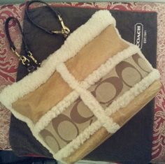 Coach Handbag (12Long/ 10Deep/ 4Wide) Beautiful bag in perfect used condition. The handles can be worn 2 ways This is a signature/leather/fur And what My niece calls a coachUgg  Clean inside an out see pic 4 this is due to normal wear. Coach Bags Satchels