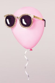 looking cool, balloon. // Karen Walker sunglasses