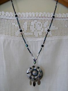 Iridescent Beads and Silver Embellished Vintage Pendant Necklace. $14.00, via Etsy.