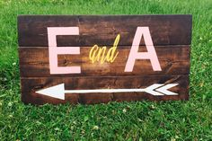 Point your guests in the right direction with this arrow sign by StarryNightDesigns via Etsy. #reception #weddingsigns