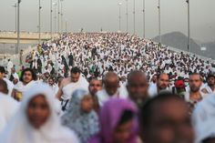 """Hundreds of thousands of Muslim pilgrims make their way to cast stones at a pillar symbolizing the stoning of Satan, in a ritual called """"Jamarat,"""" the last rite of the annual hajj, on the first day of Eid al-Adha, in Mina near the holy city of Mecca, Saudi Arabia,"""
