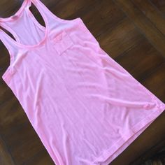 VICTORIA's SECRET NWOT LONG TANK. Small This Victoria's Secret long tank has never been worn in a neon pale pink. So cute. Long enough for bathing suit coverup or leggings. Great color for spring and summer. Small Victoria's Secret Tops Tank Tops