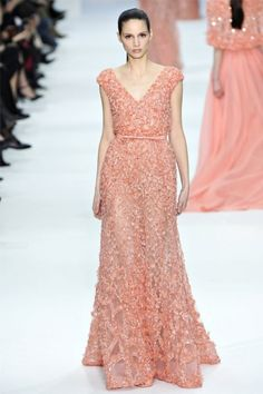 Elie Saab presented a romantic collection of ivory and pastel hues of powder blue, rose and wheat for his spring 2012 haute couture show in Paris