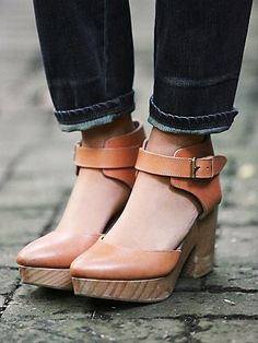 Percy Clog | Distressed leather pointy toe platform clogs with tonal leather ankle wrap, featuring an adjustable buckle. Grainy wooden heels with padded leather insoles. *By Free People