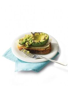 Avocado toast is having a moment -- the mild fruit is a perfect foil to just-crunchy-enough bread. For a summery twist, lightly grill your avocado before dousing it with quality olive oil, fresh Parmesan shavings, and a squeeze of lime. Avocado Recipes, Healthy Recipes, Veggie Recipes, Avocado Dishes, Avocado Food, Avocado Dessert, Healthy Meals, Delicious Recipes, Grilled Avocado