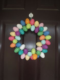 Egg Wreath-made with plastic eggs from Target (had holes in them already), strung with them floral wire which didn't shape it right, so I got a metal wreath that I attached it to, and then wrapped the wreath in ribbon (but I don't think it really needed that)