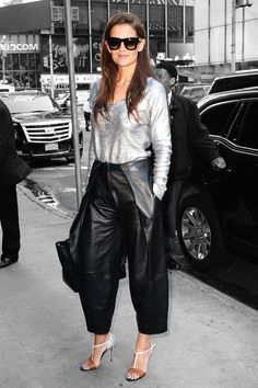 Katie Holmes looked to the future for an appearance on Good Morning America. We can't wait to pair a silver v-neck sweater with baggy, cropped leather pants in the fall. #refinery29 http://www.refinery29.com/2015/07/91164/katie-holmes-leather-pants-outfit#slide-1