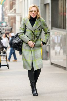 So trenchy, so chic! Cate Blanchett looks effortlessly stylish in a green plaid trench coat and black leather boots as she struts through New York City on Thursday