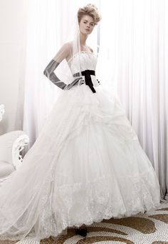 Black and White bridal dress. The black belt and gloves add a sexy touch to this beautiful lace #wedding dress.