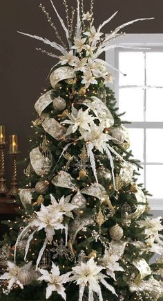 Cream ribbon, silver and gold ornaments with flowers. I don't like the top of the tree
