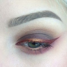 red and gold wing liner, brown eyeshadow