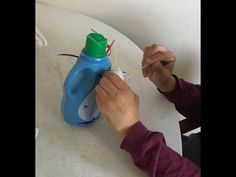 Here's a fun fine-motor activity that's great for all ages. I attached wiffle balls to a plastic bottle and provided lots of tie wraps to insert through. They look like spider legs to me and my client Cutting Activities, Motor Activities, Wiffle Ball, Spider Legs, Etch A Sketch, Oral Motor, Bottom Of The Bottle, Pipe Cleaners, Achieve Success