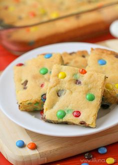 """Simple and delicious Cake Mix Cookie Bars - a great """"go-to"""" dessert recipe. { lilluna.com } Soft bars made from yellow cake mix, vanilla pudding, mini m&m's, and chocolate chips!"""