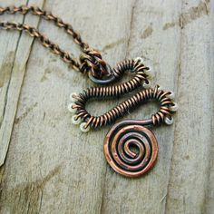 The Friendly Serpent Necklace - wrapped in antiqued copper and pearly white glass seed beads. $22.00, via Etsy.