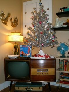 My vintage hi-fi/tv and aluminum tree. This year I did all pink and red glass ornaments and used a color-changing light. I think it was better monochromatic.