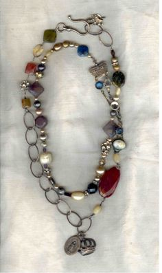 Double wrapped long necklace: stones, crystals, rhinestones, charms, and pearls.