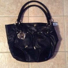 NEW Bebe purse Bebe black purse brand NEW with the tag.. In excellent condition never been used.. An question just ask? bebe Bags Shoulder Bags