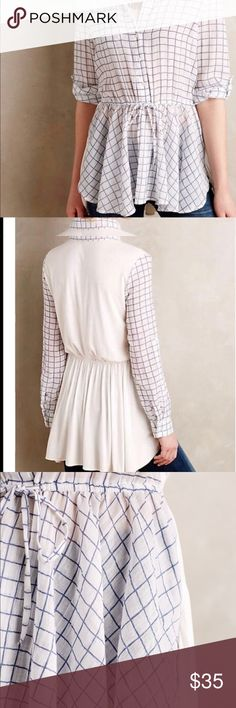 Anthropologie blue tassel windowpane peplum blouse Worn 3 times. Very flattering. Ties at the waist. Solid white back. Anthropologie Tops Blouses