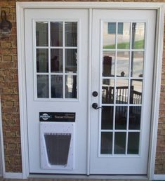 With frosted glass and doggie door for Harry and Darby to use- Master bathroom door replacement