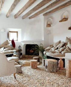 White room, raw wood beams, pebble floor.