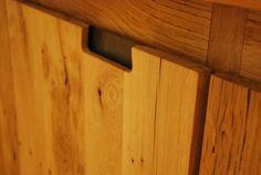 Doorhandle. Built in cabinet. Reclaimed oak wagon floorboards.