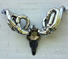 This V8 Race Header Auto Antlers is a one of a kind race inspired car guy decor item.
