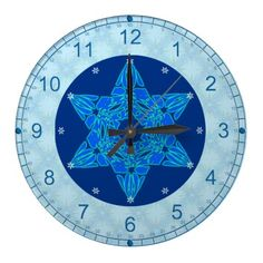Snowflake Magen David Wall Clock - Beautiful original digital painting adorns the face of this wall clock. Against a subtle background of aqua & blue snowflakes is a highly stylized blue & aqua Star of David sitting within a round navy blue medallion. Teal numerals for Hours & Minutes make this clock easy to read.  See more of Jewbilee's beautiful, original Jewish-themed products @ www.zazzle.com/jewbilee+gifts?rf=238155573613991097&tc=pnt #jewishclocks #jewishgifts #starofdavidclocks